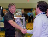 Trade show vendor meets attendees