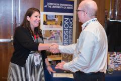 Vendor greets attendee at NACE conference job fair