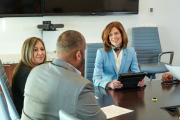 Corporate lifestyle photography of CEO Susan Salka with her AMN Healthcare team.