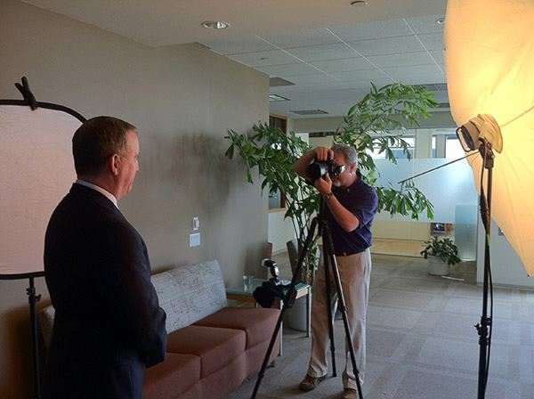 William Morton photographs investment executives in downtown San Diego