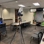 location photography setup in corporate training room