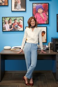 CEO casual pose in her office