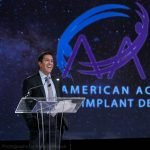 Dr. Sanjay Gupta delivers a keynote speech for the AAID conference