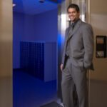 Assistant bank manager Chris De Jesus is photographed by Morton Visuals showing off the Comerica Bank vault