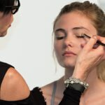 pro makeup artist at work on a model to prepare for headshots